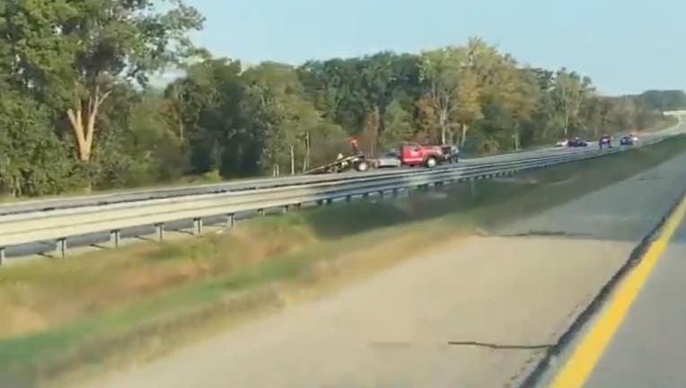 Michigan State Police investigate fatal rollover on I-75.