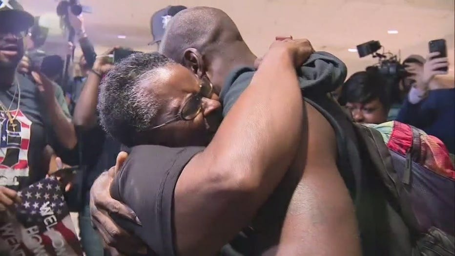Wendell Brown hugs his mother after arriving at Metro Airport in 2019.