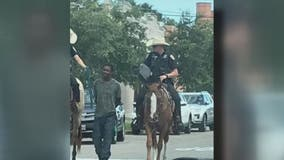 Black man sues Texas city for $1M after viral photo showed mounted officers leading him by rope