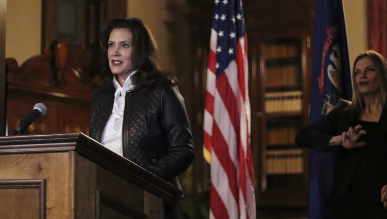 Gov. Gretchen Whitmer stands behind a podium in front of an American flag and addresses the public after a plot to kidnap her was unraveled.