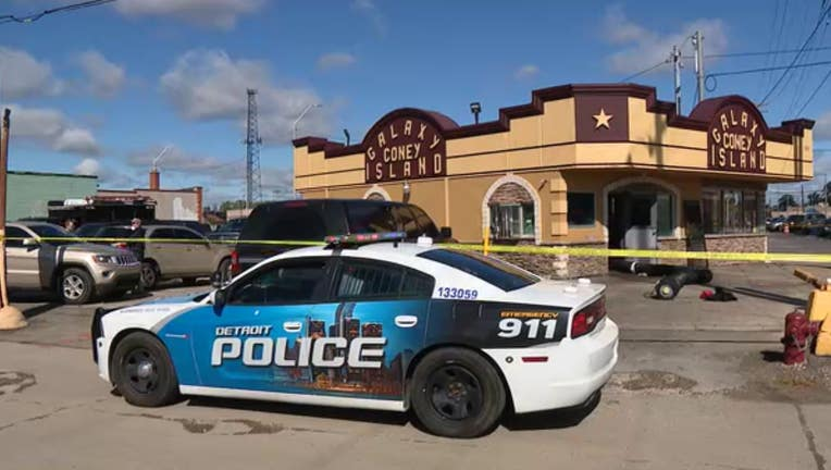 A Detroit police vehicle sits outside the Galaxy Coney Island, which has been taped off with crime tape.