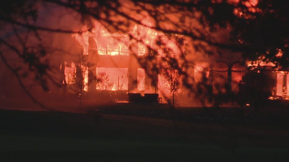 This house fire reduced a mansion to a total loss Friday.