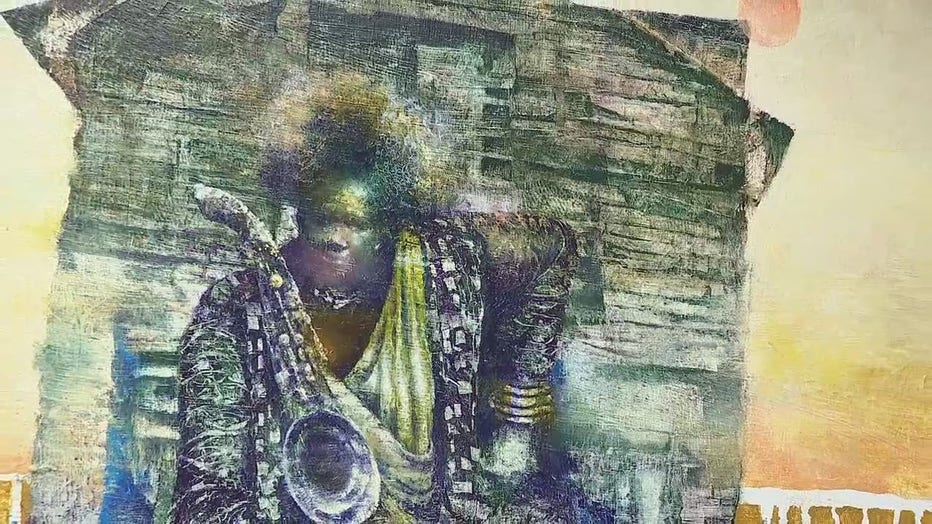 This painting by Black artist Paul Goodnight is one of the showcased pieces at Umoja Fine Arts Gallery .