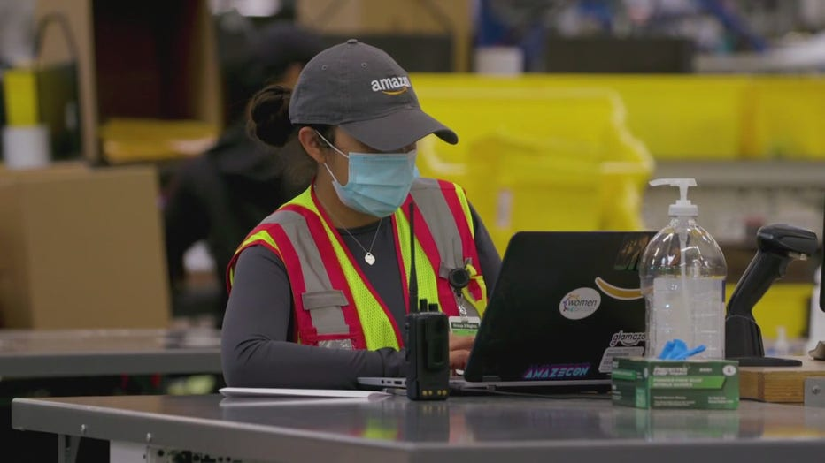 Amazon worker at a distribution center.
