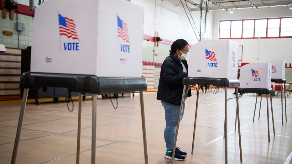 A voter fills out a ballot at Edmondson High School in Baltimore, Md., on April 28, 2020. (Photo By Tom Williams/CQ-Roll Call, Inc via Getty Images)
