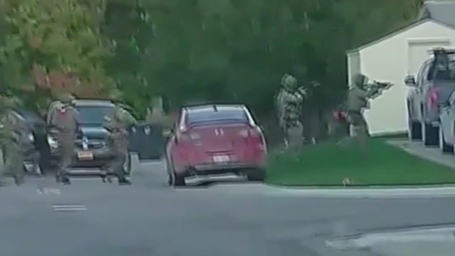 A raid at a suspected militia member's residence in Hartland Wednesday. Still photo from video by: Austin Burnett via TMX.news.