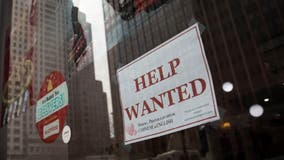 Unemployment claims fall to a still-high 900,000