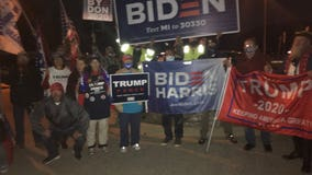 Michigan harmony: Trump and Biden supporters pause to sing 'God Bless America'