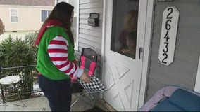 Teacher makes special deliveries to students with gifts, care packages