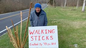 Retired Air Force colonel, 93, whittles walking sticks to raise money for food bank