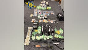 Michigan State Police drug bust uncovers luxury cars, $800,000 in cash, 36,000 illegal pills, 9 guns