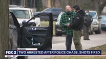 Two men in custody after firing shots at police during chase
