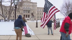 Sparse crowd of protesters in Lansing on inauguration day