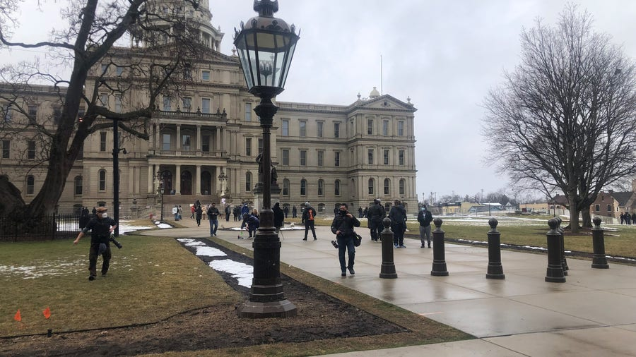 Small group of protesters act peacefully at state Capitol among heavy police presence