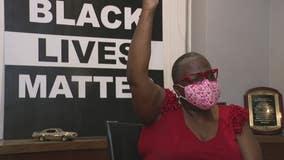 Black woman whose neighbor hung KKK flag up, recounts previous gun firing incident