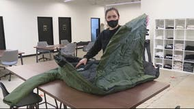 Non-profit makes and delivers coats that convert into sleeping bags for homeless