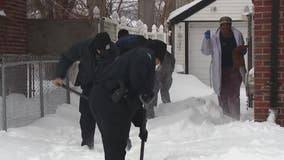 Detroit police officers shovel snow for elderly residents after winter storm