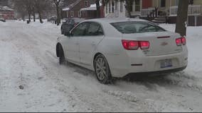 Some snowy Detroit streets remain unplowed from Monday's snowstorm