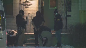 FBI seen handcuffing woman, removing weapons after west Detroit raid