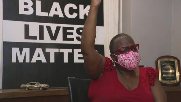 Black woman whose neighbor hung KKK flag up, recounts previous gun firing incident