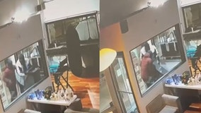 VIDEO: Men smash Royal Oak salon door with rock, steal ATM