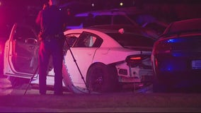 Two arrested after pointing guns at Detroit police and crashing into police cruiser