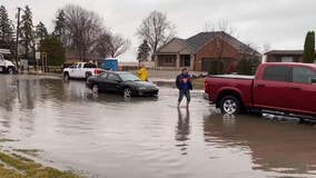 Windy and wet start to Friday knocks power out, floods roads in Metro Detroit