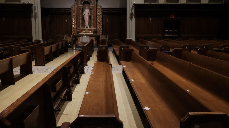 FILE - Empty pews are marked for spacing in a Manhattan church on Nov. 27, 2020 in New York City. (Photo by Spencer Platt/Getty Images)