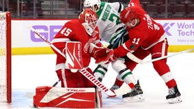 Benn scores in OT, lifts Stars to 2-1 win over Red Wings