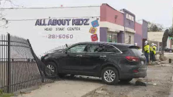 Woman loses control, crashes into Detroit daycare fence