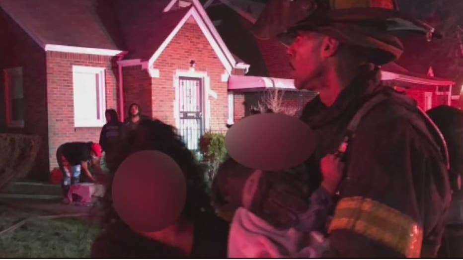Detroit Firefighter Lavaughn Williams with the baby he rescued inside the burning home.