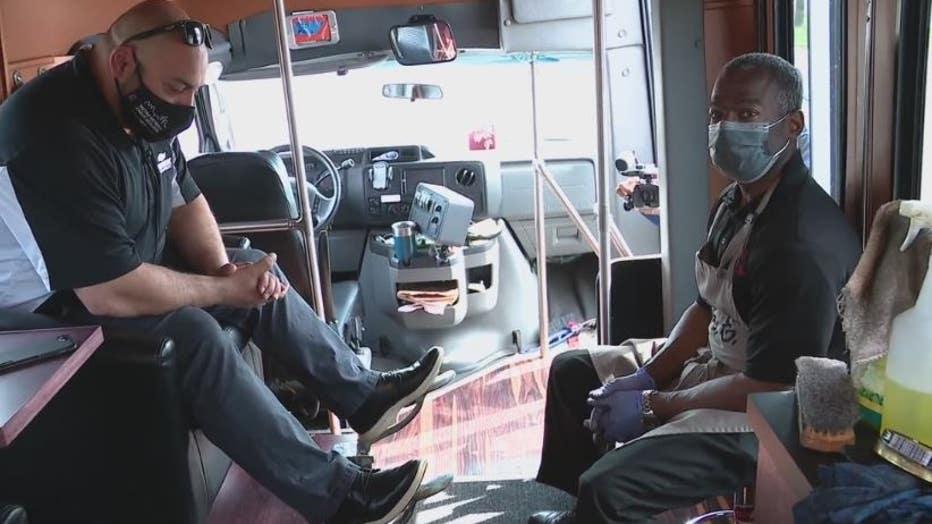 Mr. E and a customer inside the mobile shoeshine shuttle.