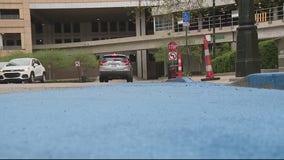 Detroit pizza shop owner paints street blue after people get parking tickets