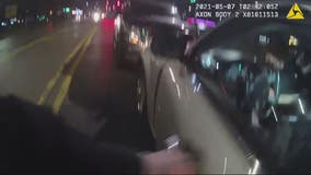 Police bodycam video shows rescue of overdosing driver inside running car