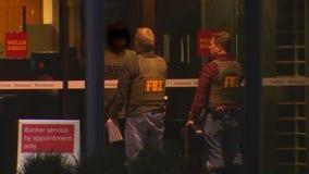 Hostages safe, suspect taken into custody after St. Cloud bank standoff
