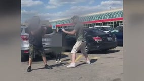 Two men brawl in front of young child in Meijer parking lot after alleged road rage