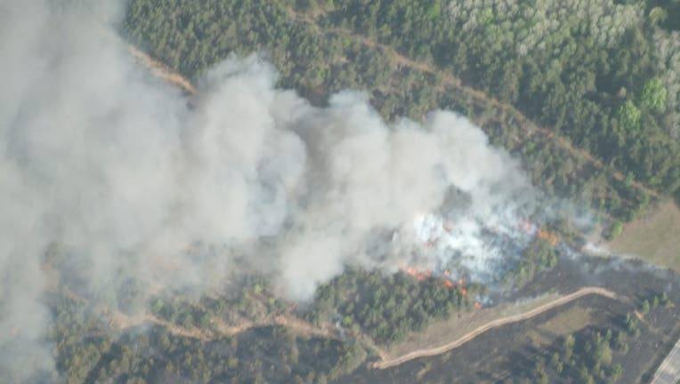 A fire in northern Michigan has burned 425 acres and forced evacuations of around 75 homes.