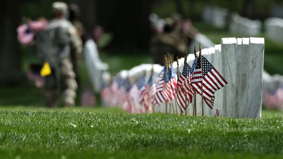 14ca737f-Arlington National Cemetery Holds Annual Flags-In To Honor Fallen For Memorial Day