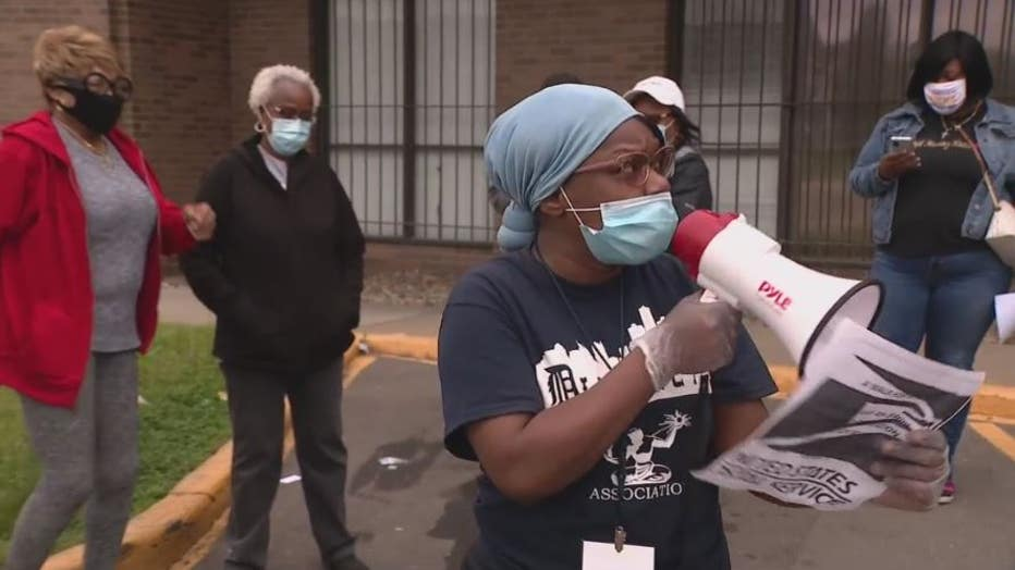 Protesters gather outside a Detroit post office, outraged with delays in delivery.