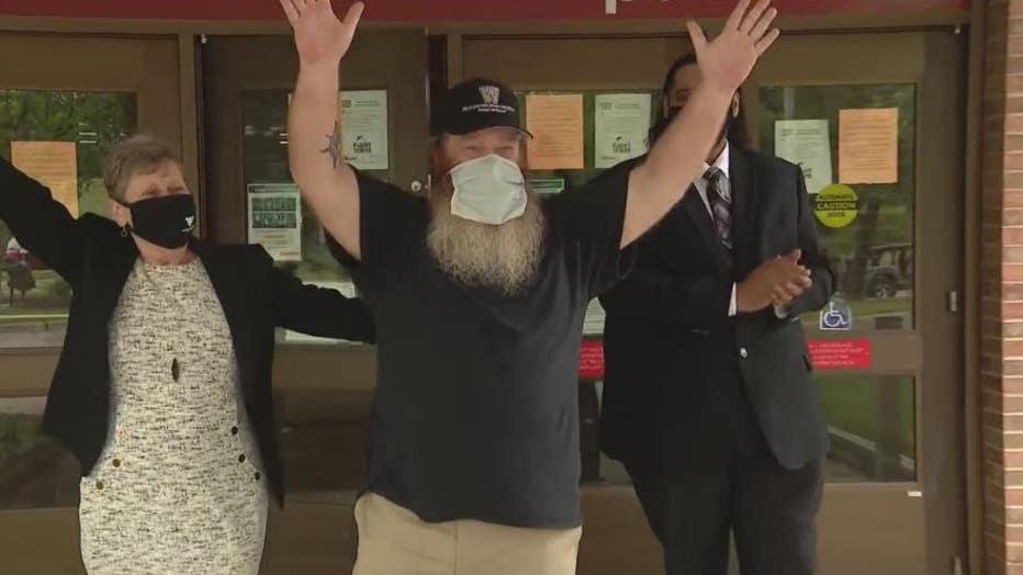 Gilbert Poole Jr. celebrates walking out as a free man.
