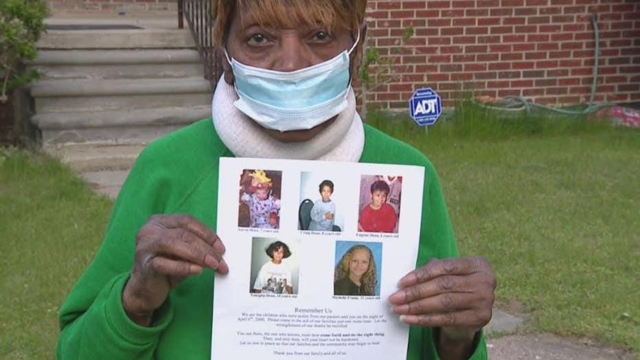 Dorothea Pullen holds pictures of the five children who died in the fire next door 21 years ago.