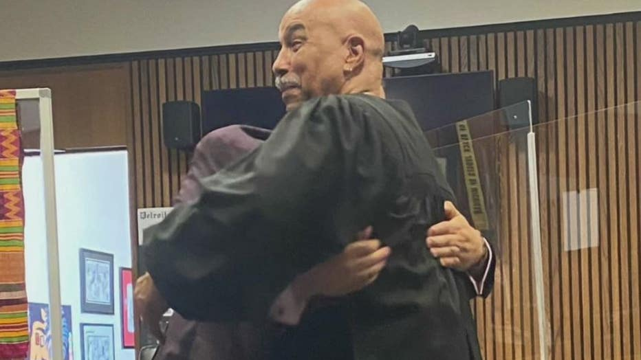 Ed Martell bear hugs Judge Bruce Morrow after being sworn in as attorney.