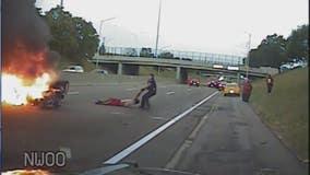Video: Police officer pulls man from burning car after I-94 crash