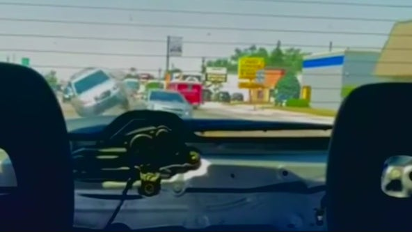 Woman catches driver distracted by phone rear-ending car in turn lane in Warren
