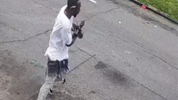 Photos released of gunman in triple shooting that wounded 11-year-old and his father
