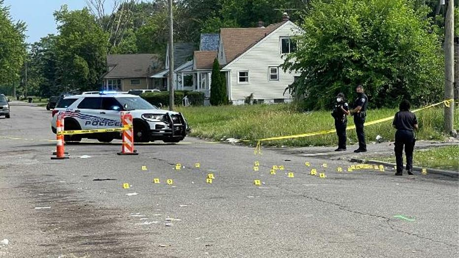 Evidence markers at the scene where a boy and his father were shot near Plymouth and St. Marys in Detroit. Photo by Veronica Meadows.