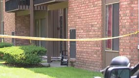 Woman in custody after man stabbed to death at Clinton Township apartment