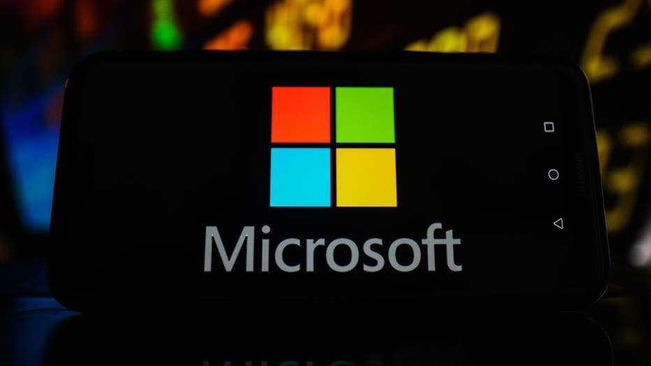 In this photo illustration a Microsoft logo seen displayed