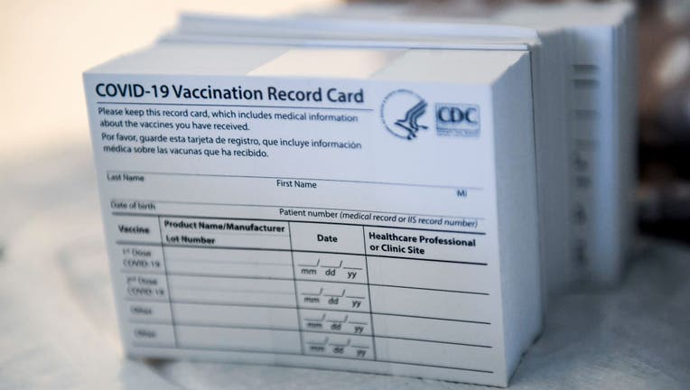 FILE - A stack of COVID-19 Vaccination Record Cards from the U.S. Centers for Disease Control and Prevention. (Photo by Ben Hasty/MediaNews Group/Reading Eagle via Getty Images)