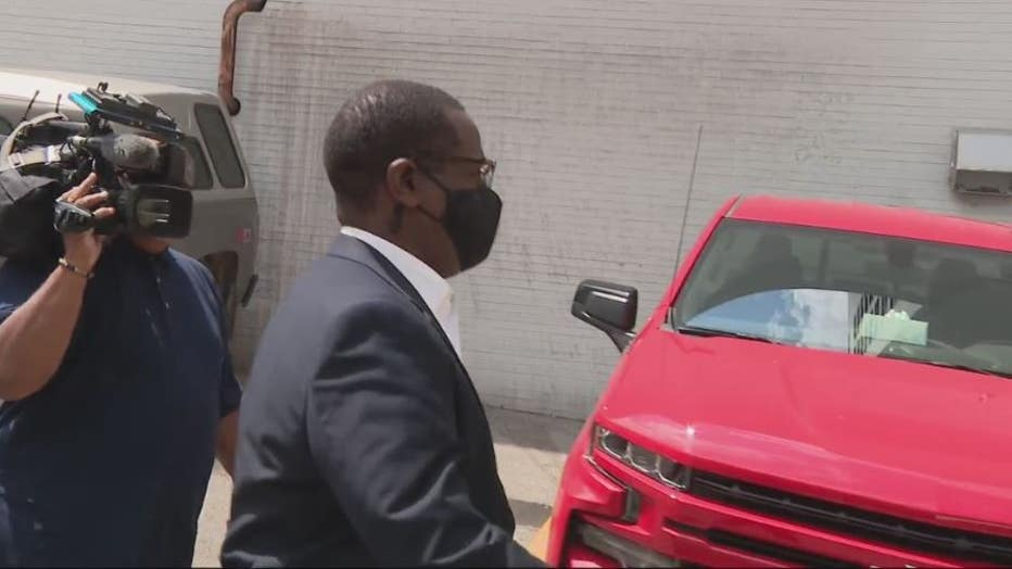 Detroit City Councilman Andre Spivey leaves federal court after a hearing on a bribery charge.